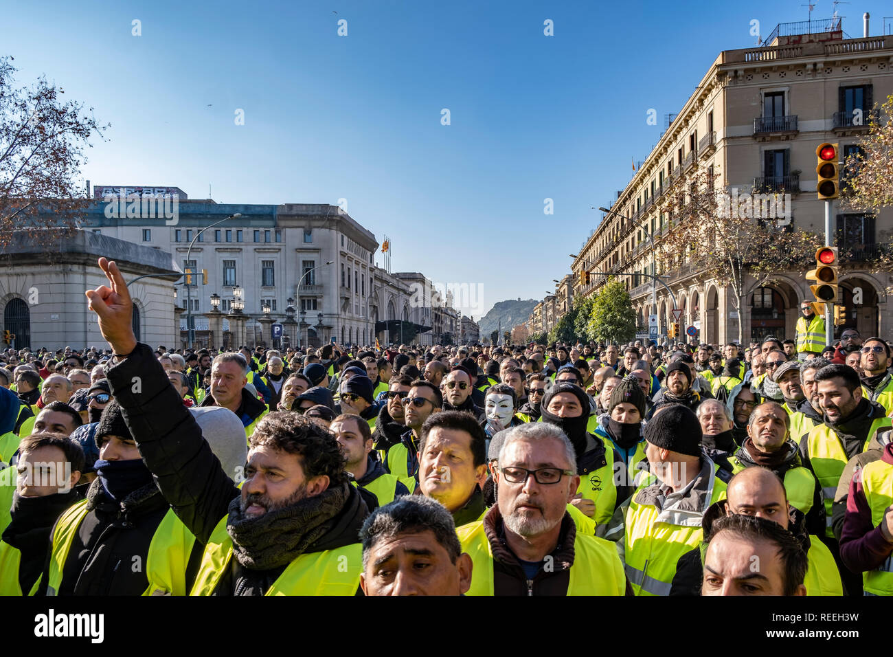 A crowd of taxi drivers with yellow vests are seen gathering in front of the Parliament of Catalonia during the strike. Fourth day strike, After not being received in the Parliament of Catalonia, the taxi drivers in demonstration have cut off traffic from Ronda del Litoral route, The pre-reservation time of the VTC services (Uber and Cabify), which the Government wants to fix in 15 minutes and the unions in 12 hours, it is the strong point of the disagreement. Stock Photo