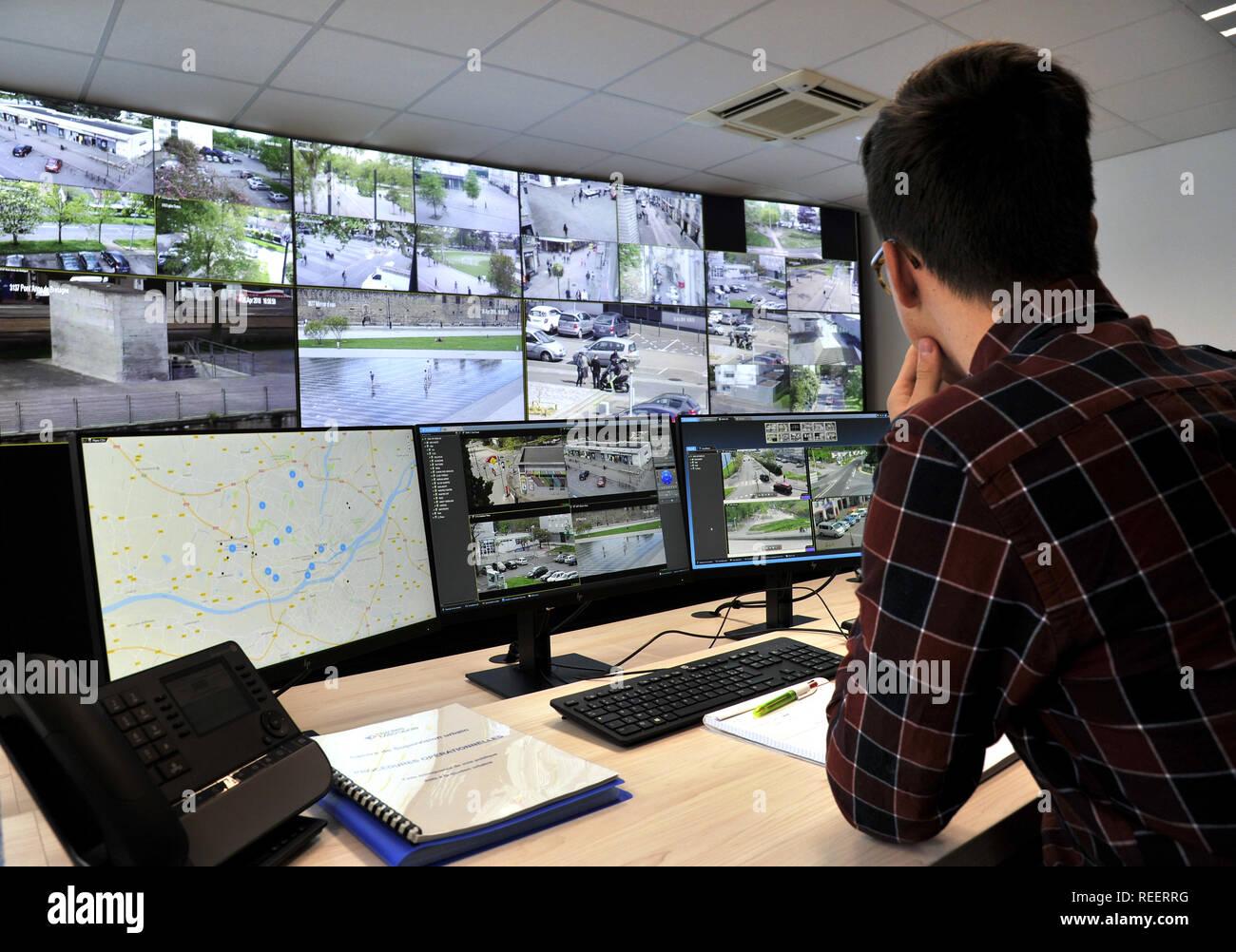 Nantes (north-western France), on 2018/04/26: Urban surveillance center ÒCentre de Supervision Urbain metropolitain pour la videoprotectionÓ. Operator - Stock Image