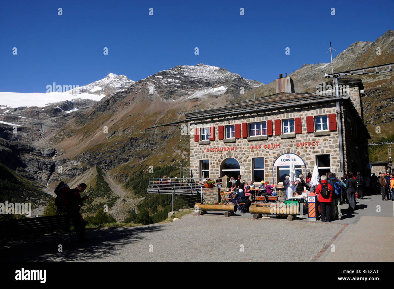 Mountain restaurant on Alp Grüm near Bernina Hospitz in the Swiss Alps - Stock Image