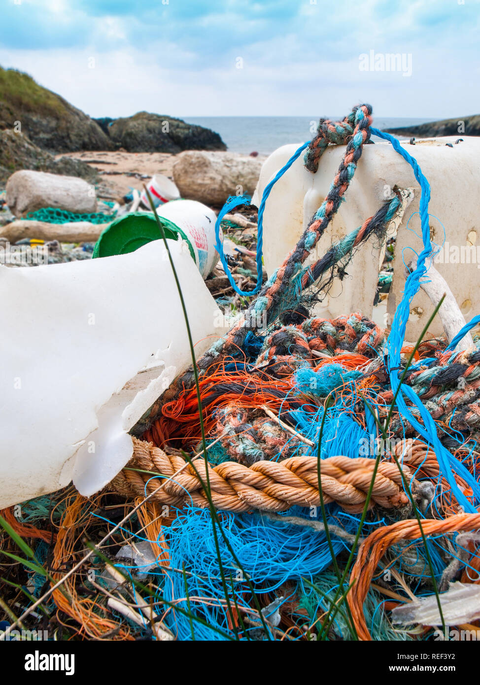 Plastics and other pollution washed up on a beach, Anglesey, Wales,UK - Stock Image