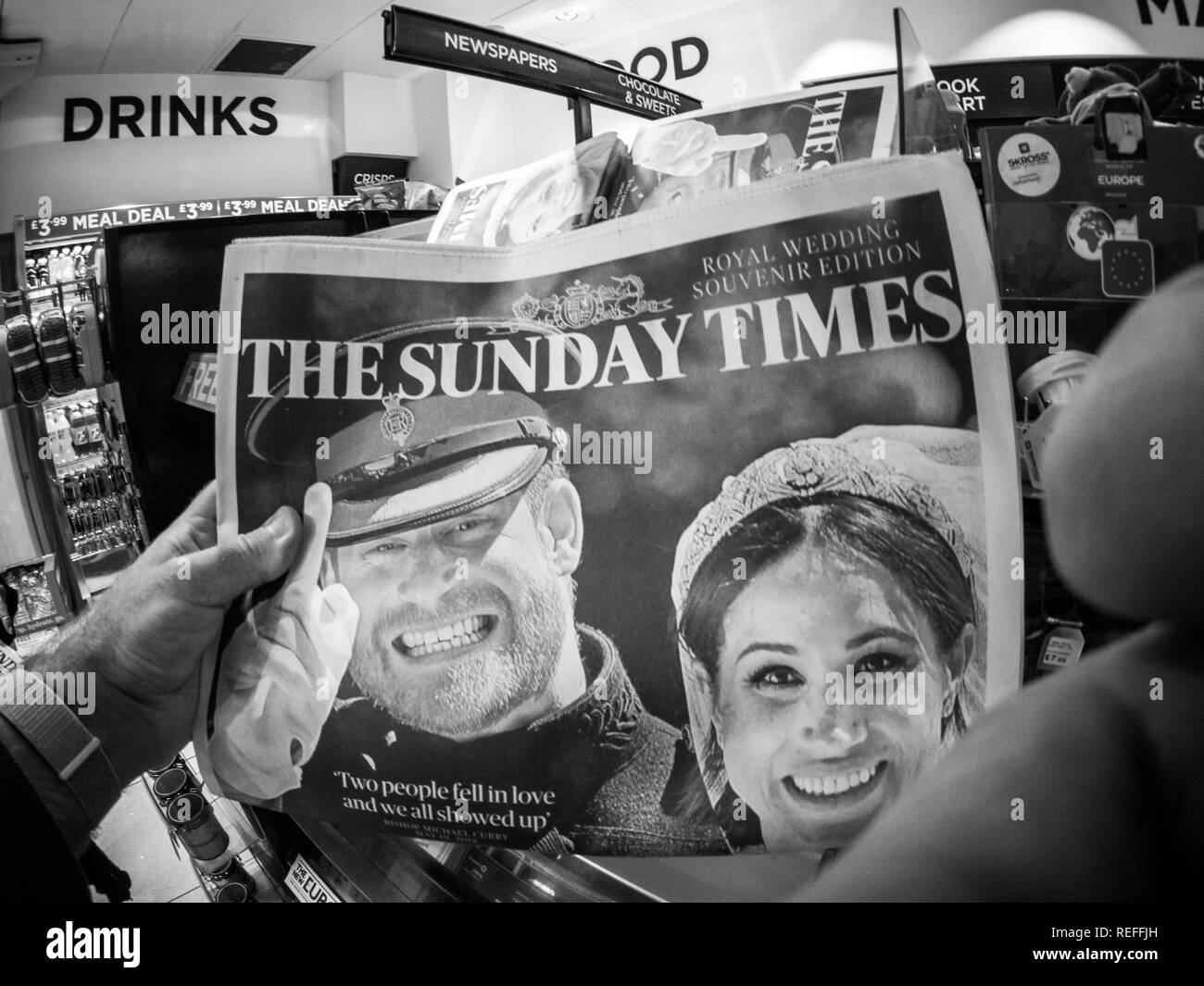 LONDON, ENGLAND - MAY 20, 2018: POV The Sunday Times front cover newspaper in British press kiosk featuring portraits of Prince Harry and Meghan Markle black and white ifestyle event - Stock Image