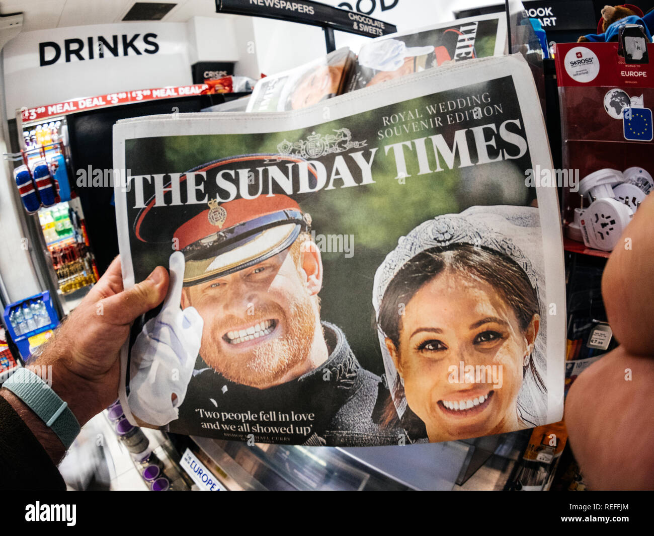 LONDON, ENGLAND - MAY 20, 2018: POV The Sunday Times front cover newspaper in British press kiosk featuring portraits of Prince Harry and Meghan Markle following the Royal Wedding lifestyle event - Stock Image