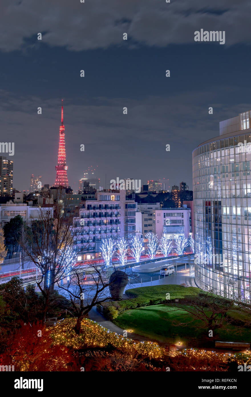 Night view at Mori Garden during winter illumination with Tokyo tower as background, Tokyo, Japan. - Stock Image