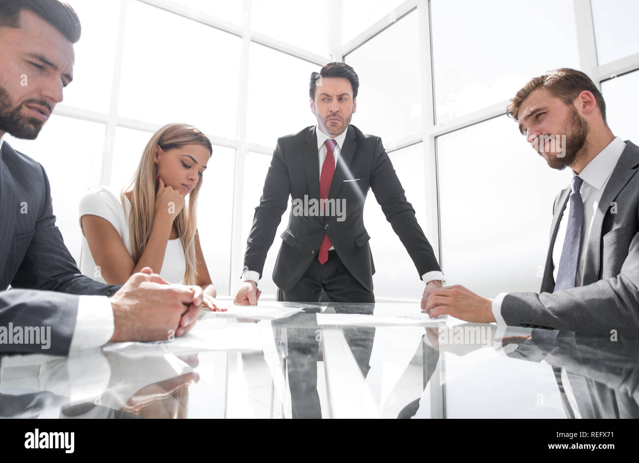 strict businessman holds a working meeting with the business team - Stock Image