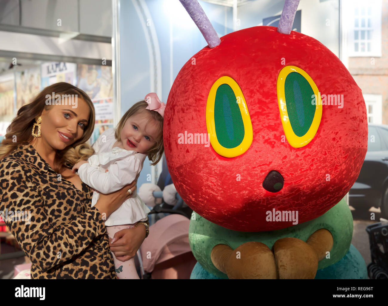 London, UK. 22nd Jan, 2019. Amy Childs, English television personality, model, businesswoman and fashion designer along with her Daughter, Polly, attend The Toyfair which opened at Olympia in Kensington, London and is open daily until the 24th January 2019. The Toy Fair is the UK's largest dedicated toy, game and hobby trade show which takes place annually. The toy industry's showcase welcomes more than 270 companies exhibiting thousands of products to visitors including retailers, buyers, media and the wider industry. Credit: Keith Larby/Alamy Live News - Stock Image