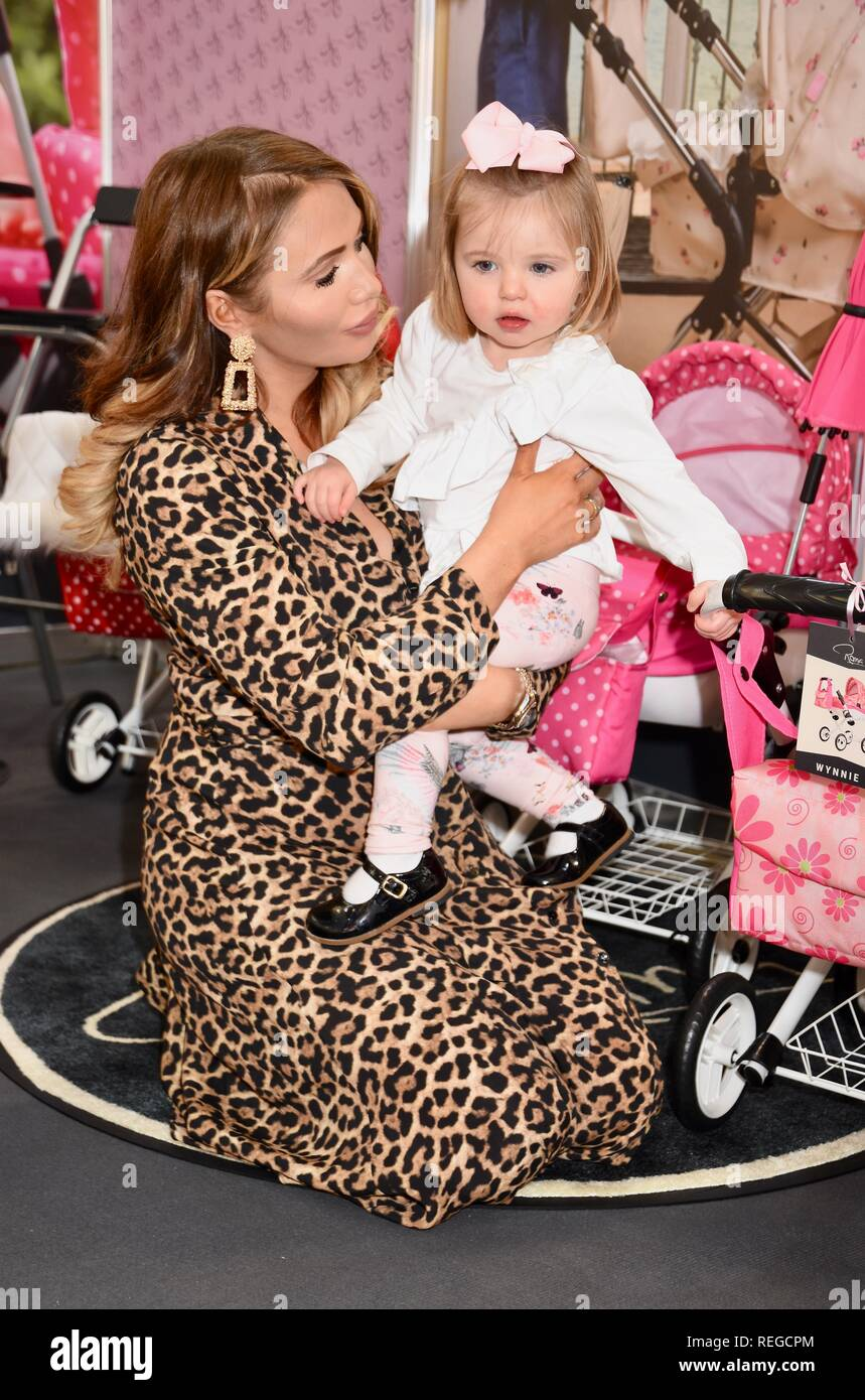 London, UK. 22nd January, 2019. Amy Childs and daughter Polly,Roma Pram Stand,The Toy Fair,Olympia,London.UK Credit: michael melia/Alamy Live News - Stock Image