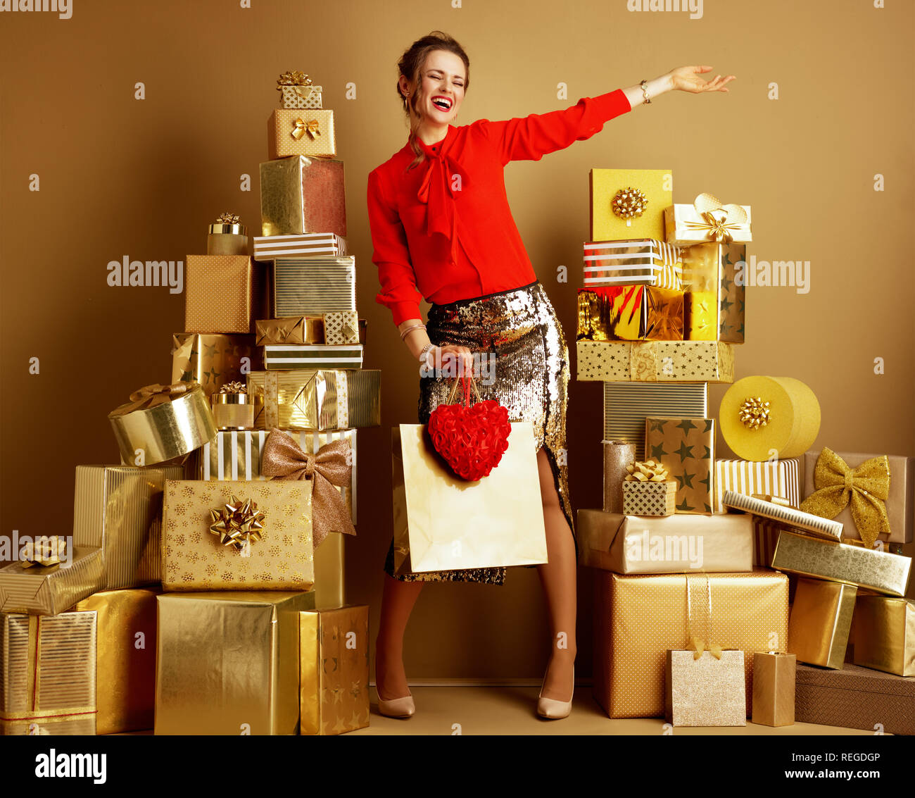 974839acfc1c Full length portrait of happy stylish fashion-monger in red blouse and  golden sparkly sequin