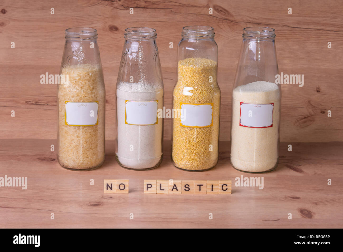No plastic sign, Four large jars full of food - Stock Image