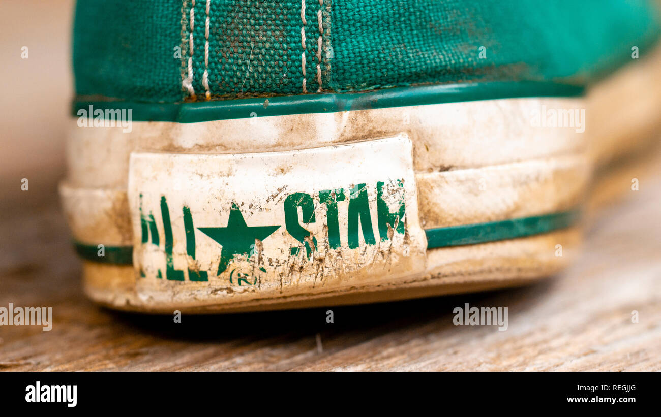 Pair of Converse Baseball Boots in worn condition, Converse is an American shoe company founded in 1908 - Stock Image