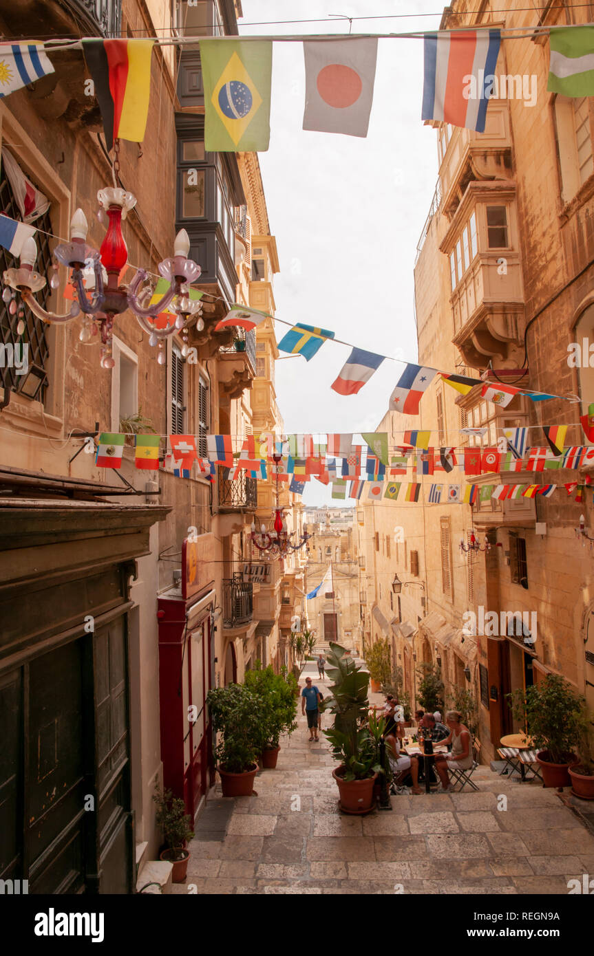 View down the steps of St. Lucia Street in Valletta, Malta with St. Lucia church at the end of it. Stock Photo