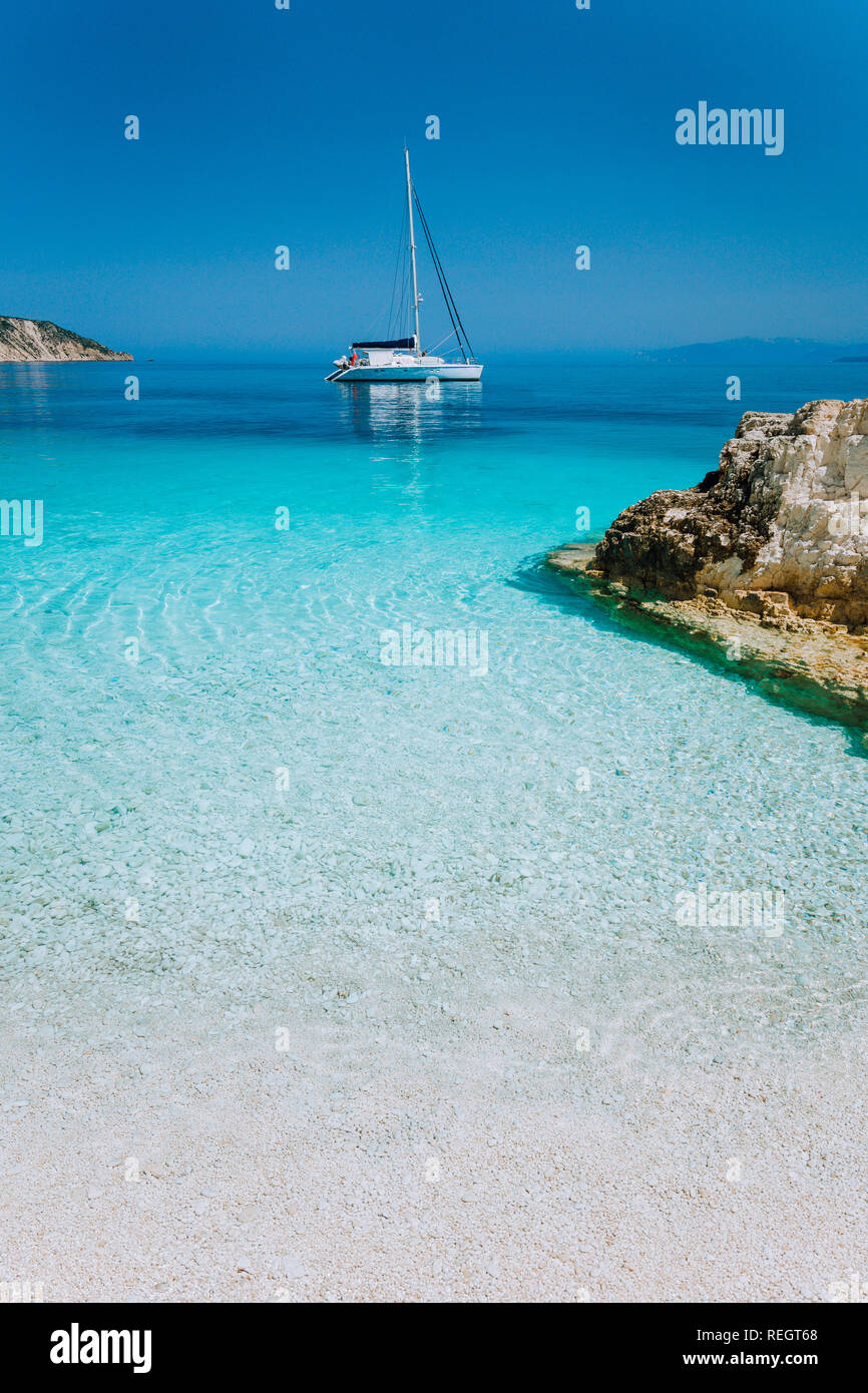 Luxury boat yacht anchored in a bay of tropical Island - Stock Image