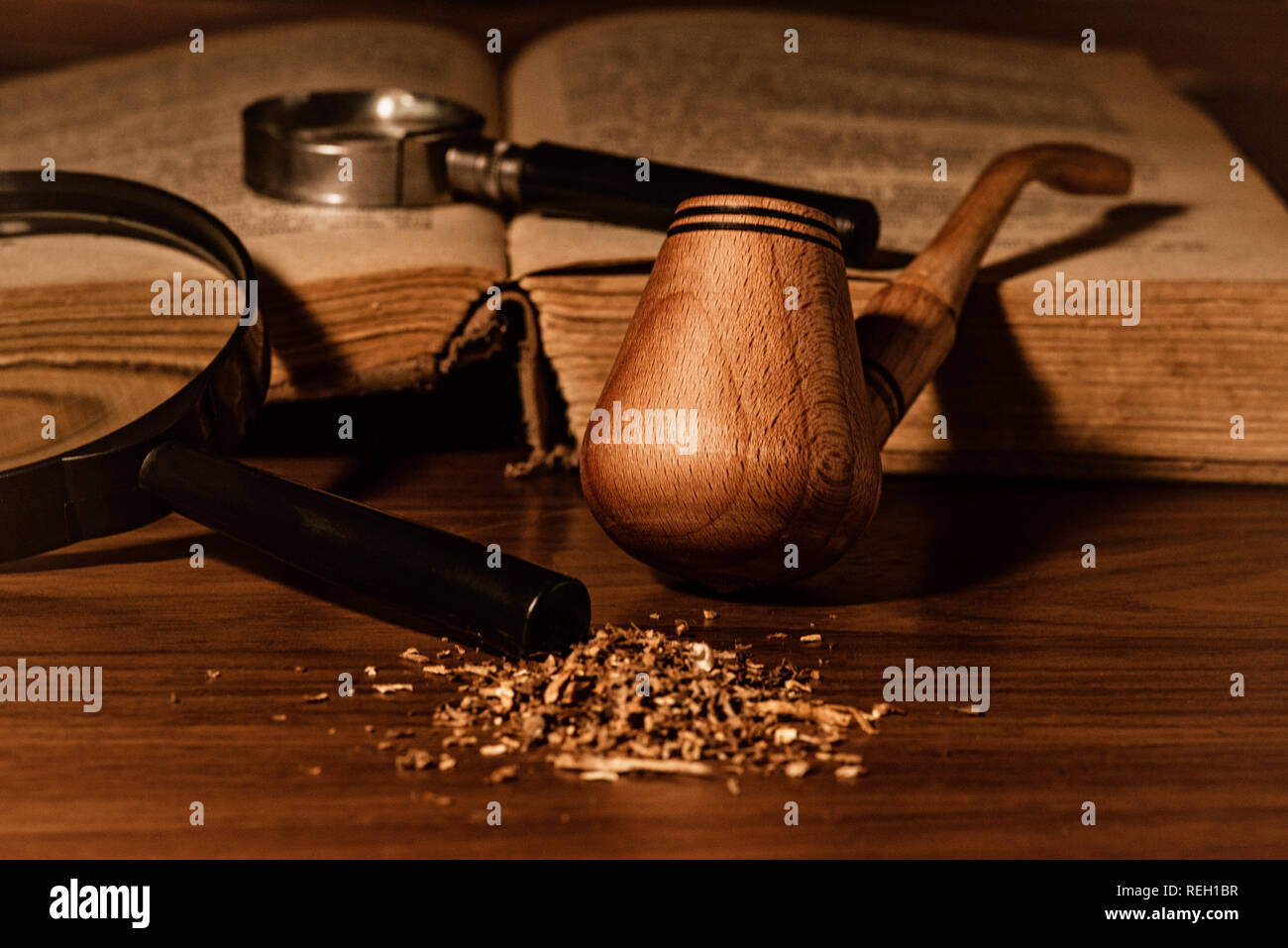 Smoking pipe with tobacco leaves on wooden background.wooden background. - Stock Image