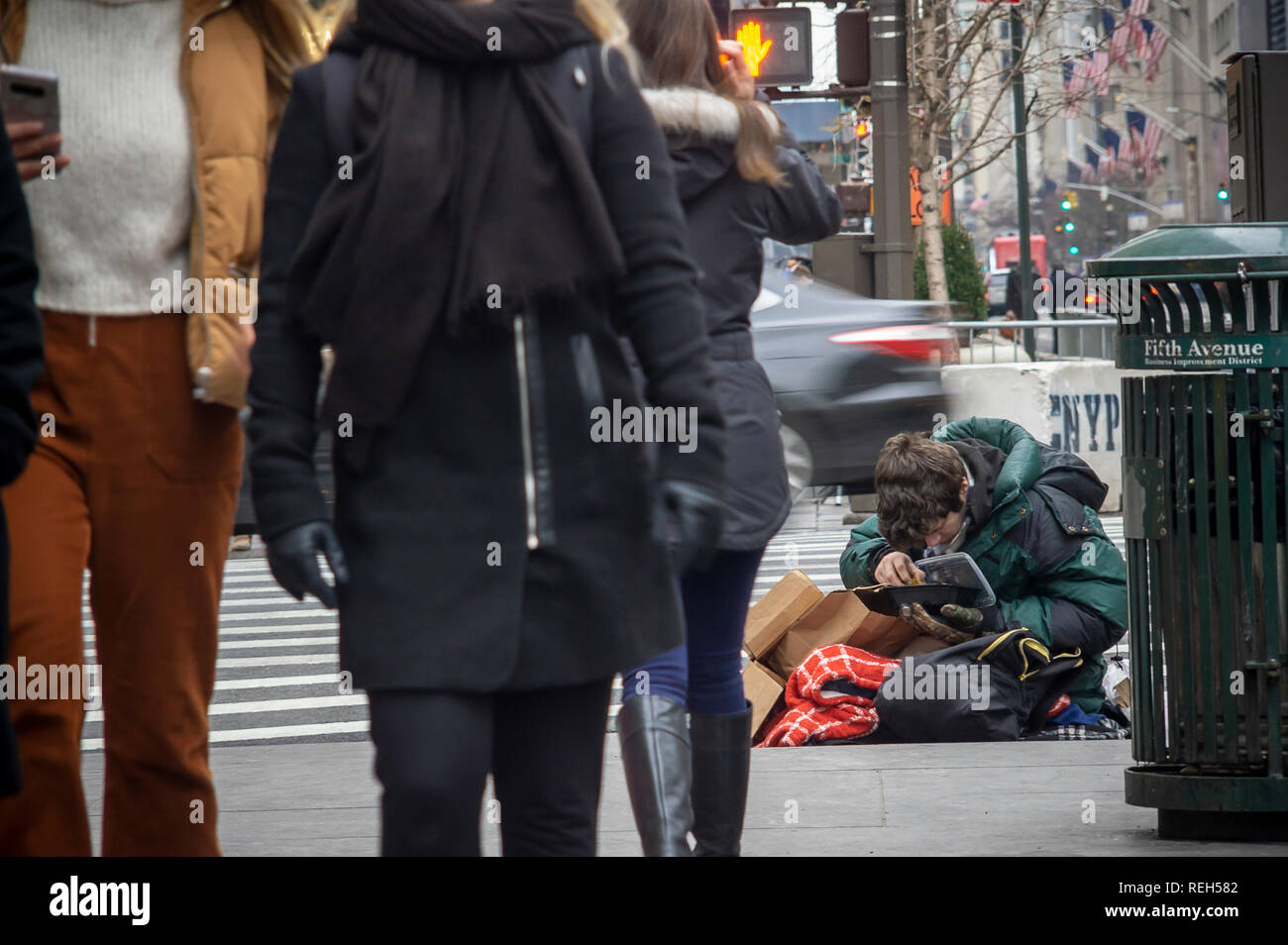 An individual begs in Midtown Manhattan in New York on Saturday, January 19, 2019. (© Richard B. Levine) - Stock Image