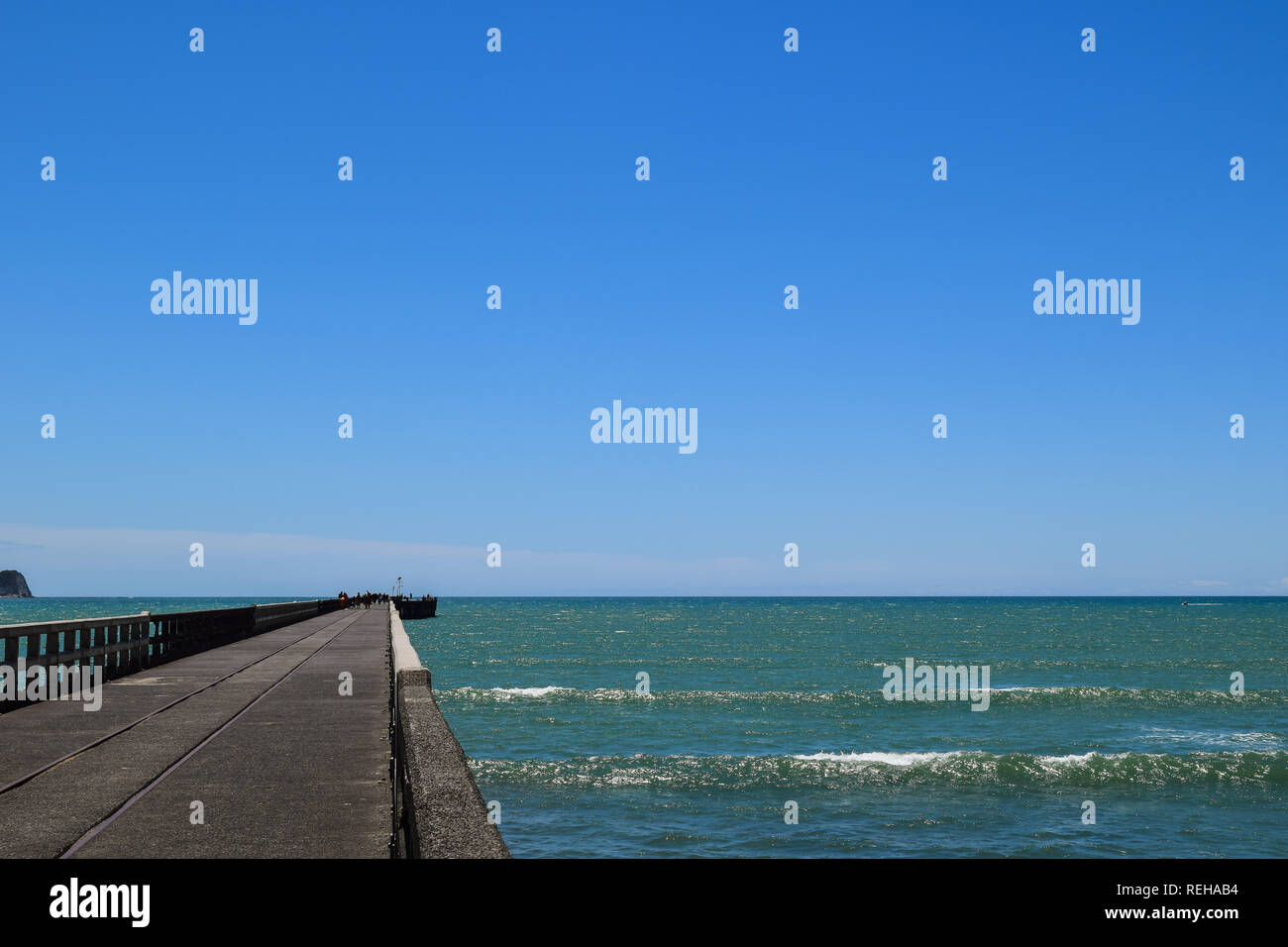 The length of the pier is unknown when looking from the shore in Tolaga Bay, New Zealand - Stock Image