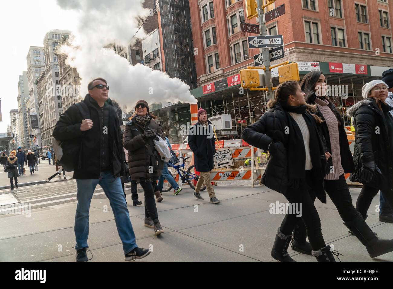 Pedestrians walk past Con Edison venting excess steam during a pipe repair in the Flatiron neighborhood of New York on Saturday, January 12, 2019. (© Richard B. Levine) - Stock Image