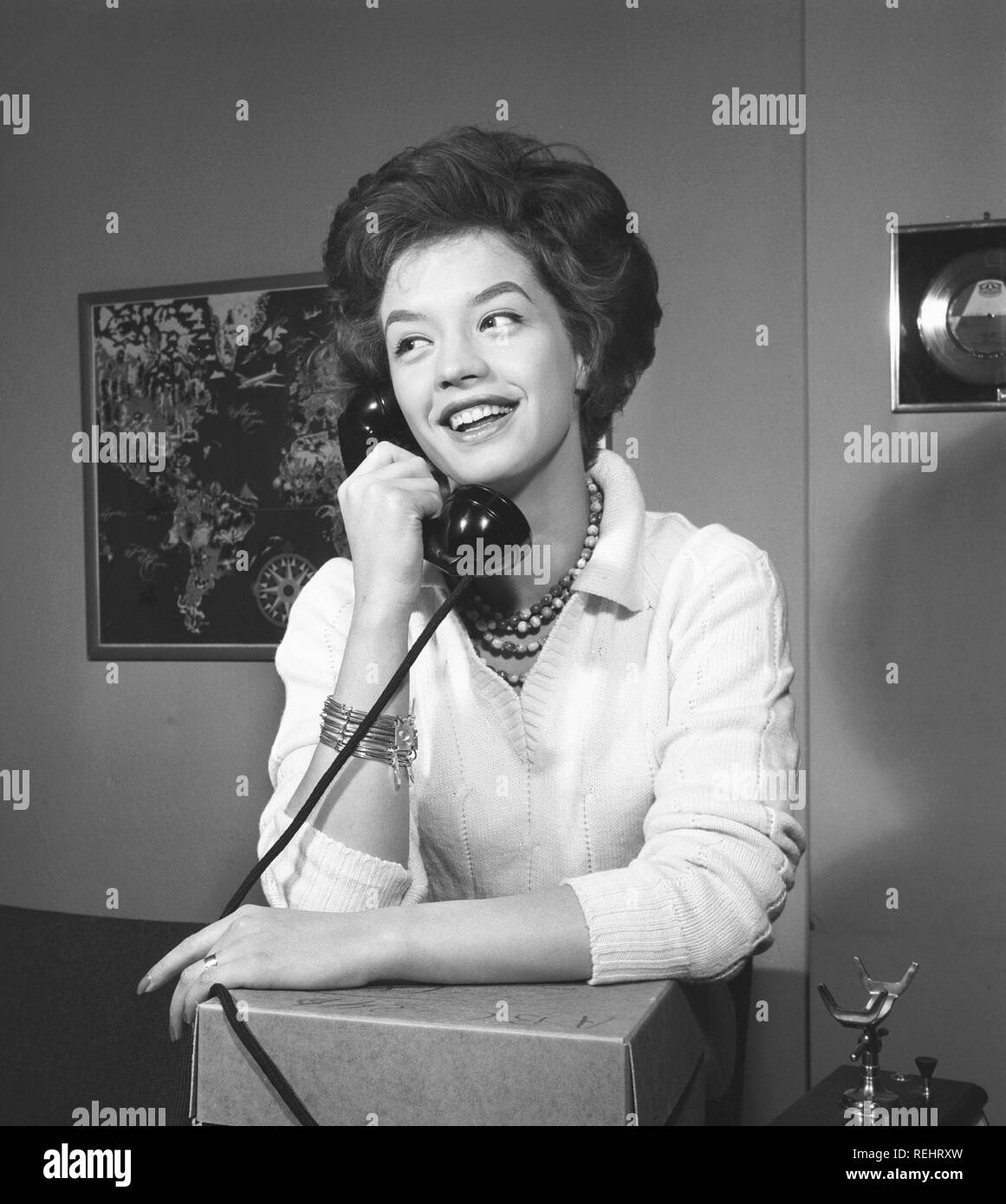 Woman in the 1950s  A young dark-haired woman speaking on
