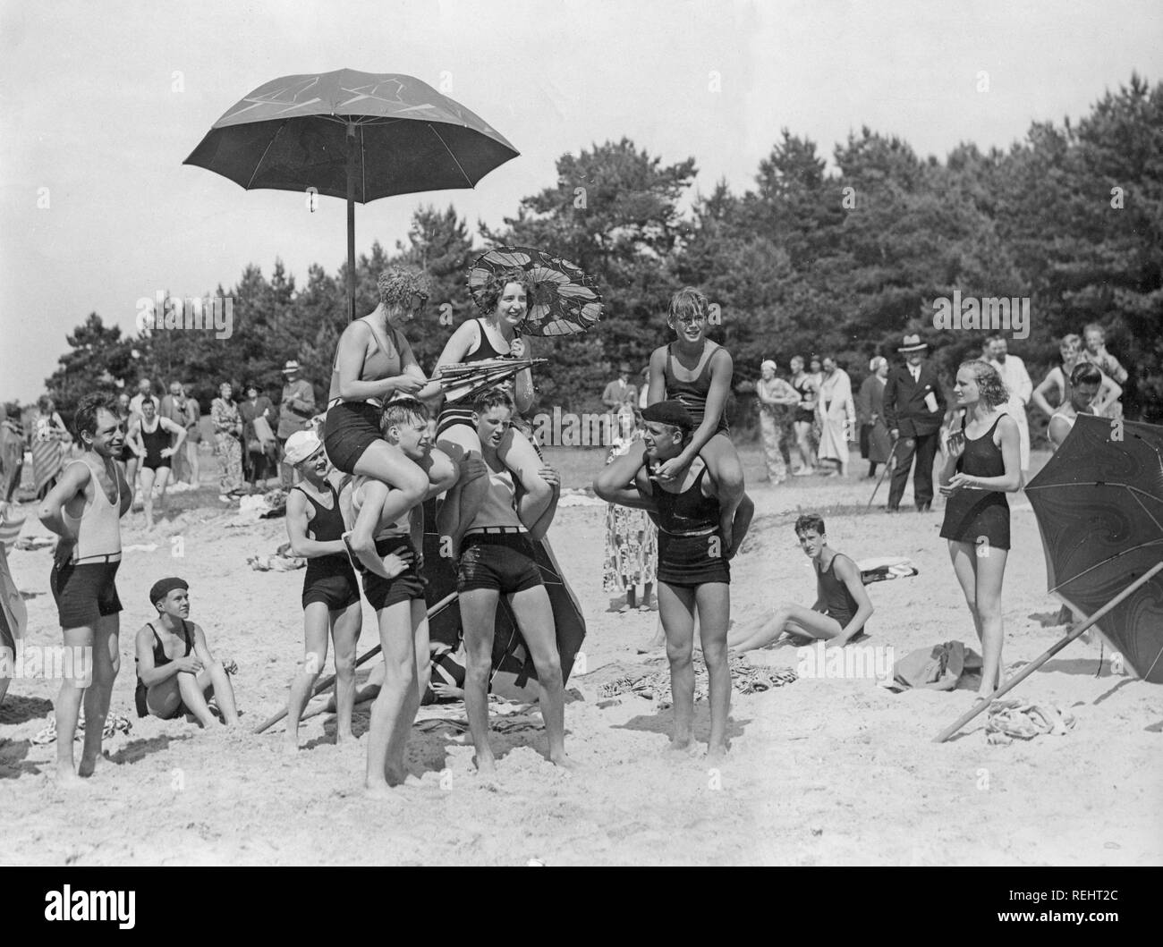 1920s beach party. A group of teenagers play on the beach outside Visby, a town on the Gotland island. Stock Photo