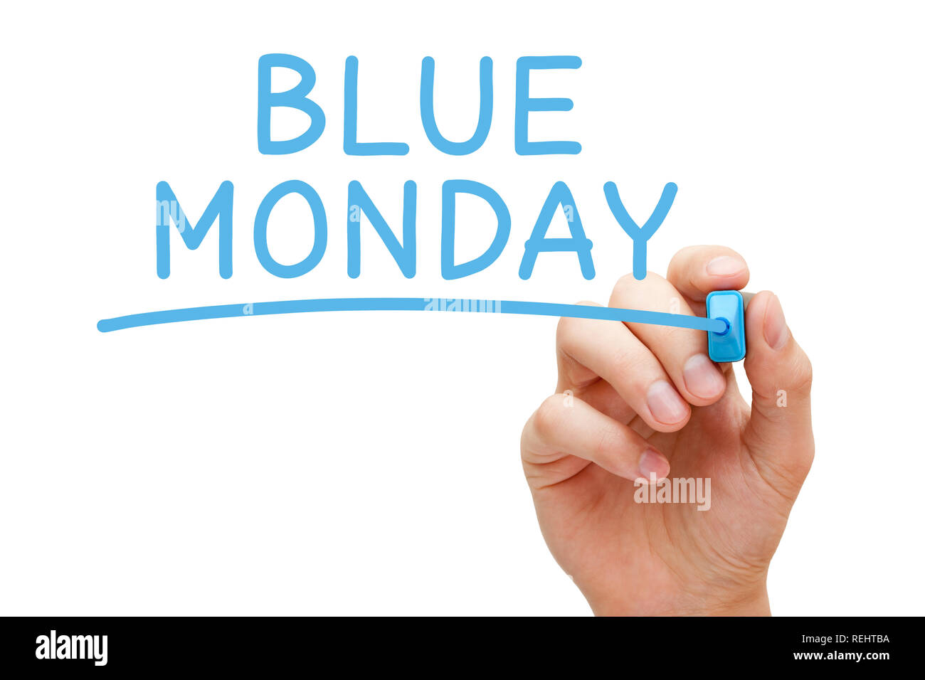 Hand writing Blue Monday with blue marker on transparent wipe board. It's claimed to be the most depressing day of the year, usually the third Monday  - Stock Image