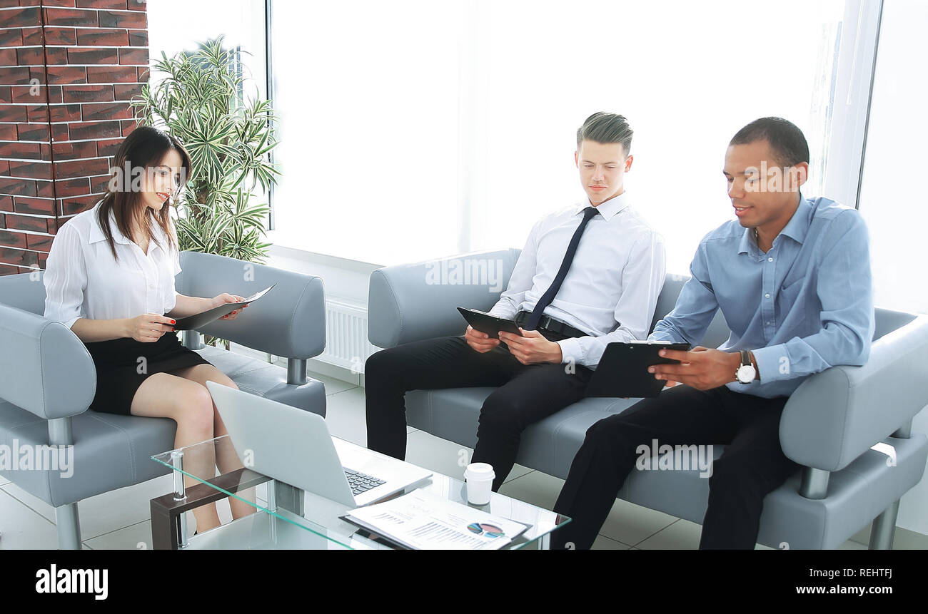 business team studying working papers, sitting in the office Stock Photo