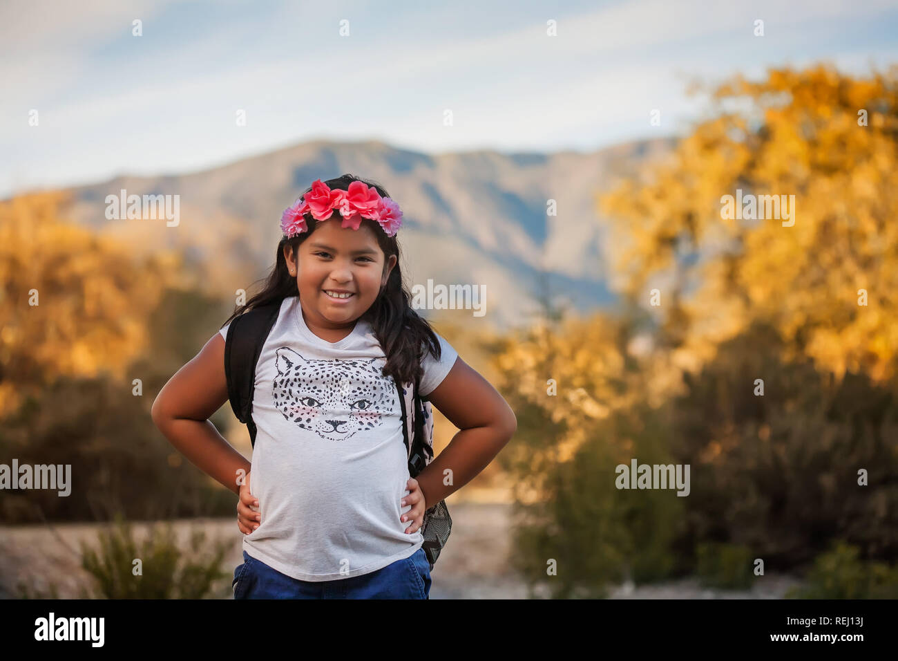 A pre teen female student wearing a backpack during a school field trip in California. - Stock Image