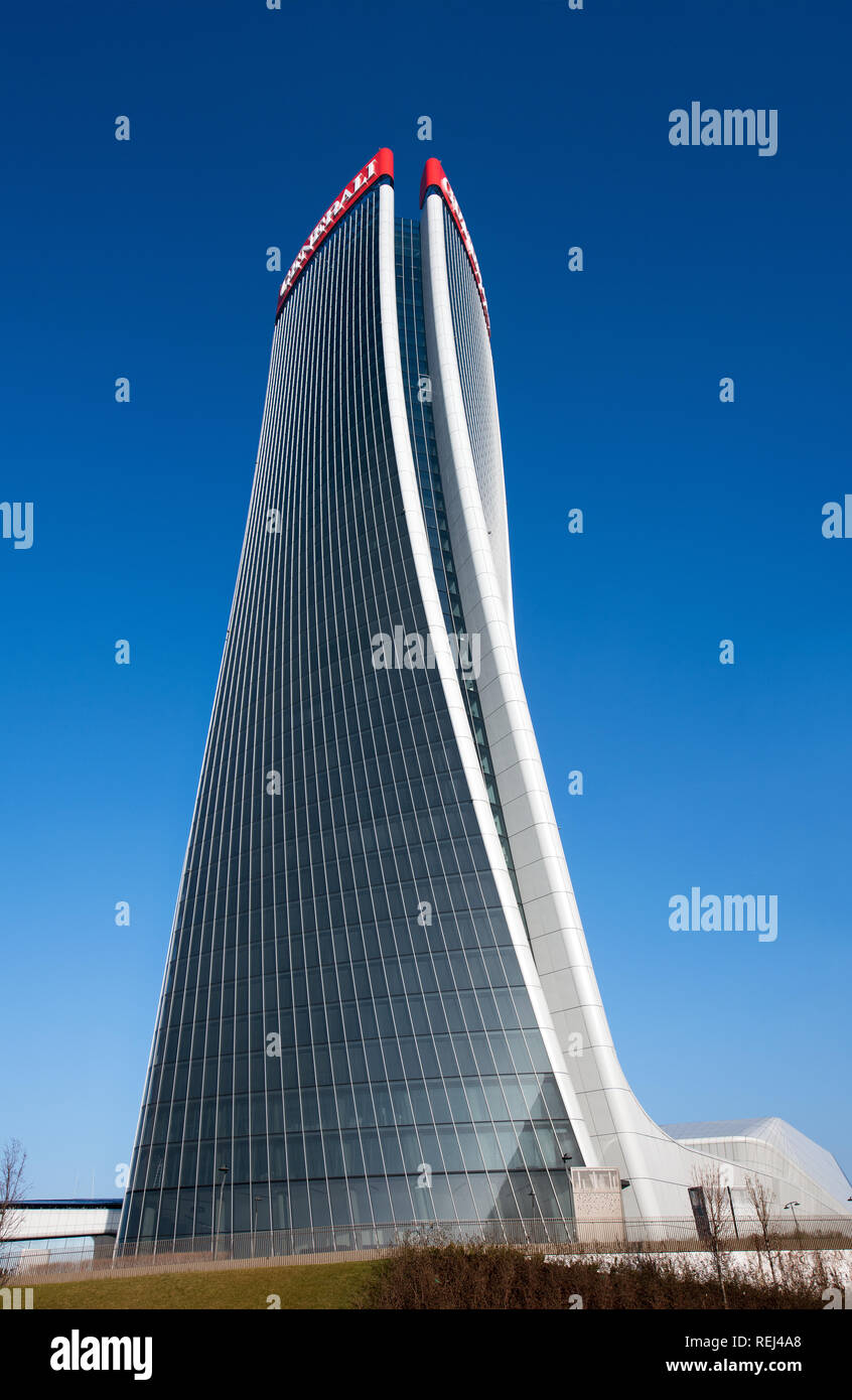 Full length view of the Generali Tower, Milan by architect Zaha Hadid with a modern design warping on its axis in a graceful curve - Stock Image