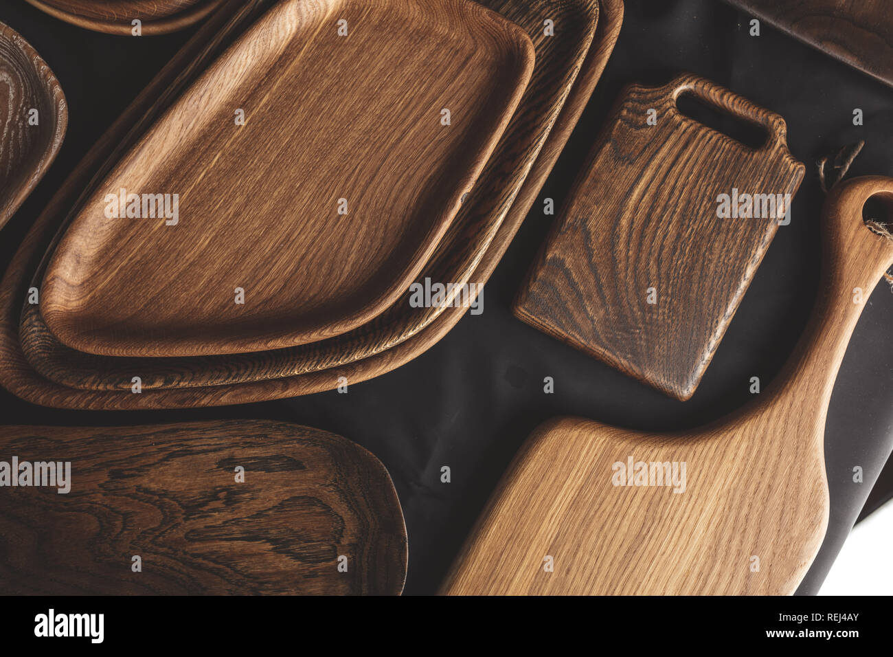 Set of cutting boards on wooden background Stock Photo