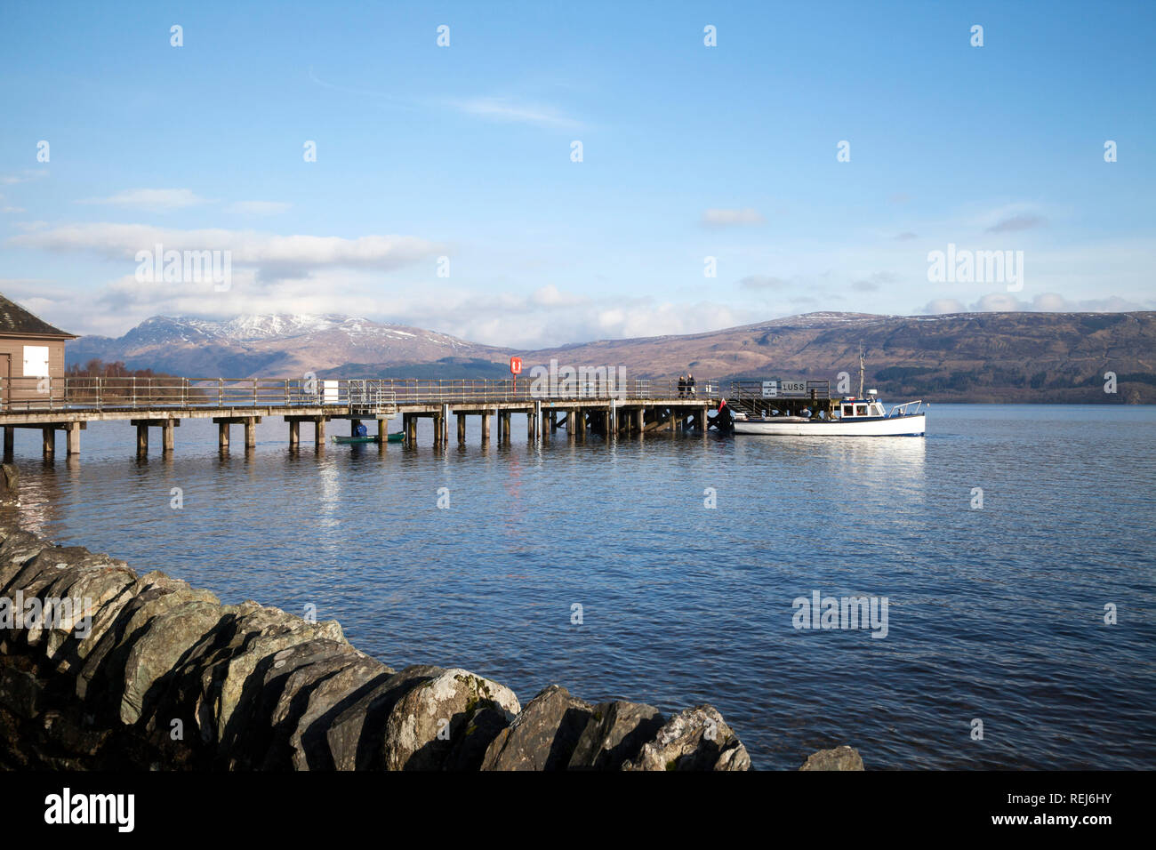 Water taxi at Luss Pier on Loch Lomond, Argyll, Scotland - Stock Image