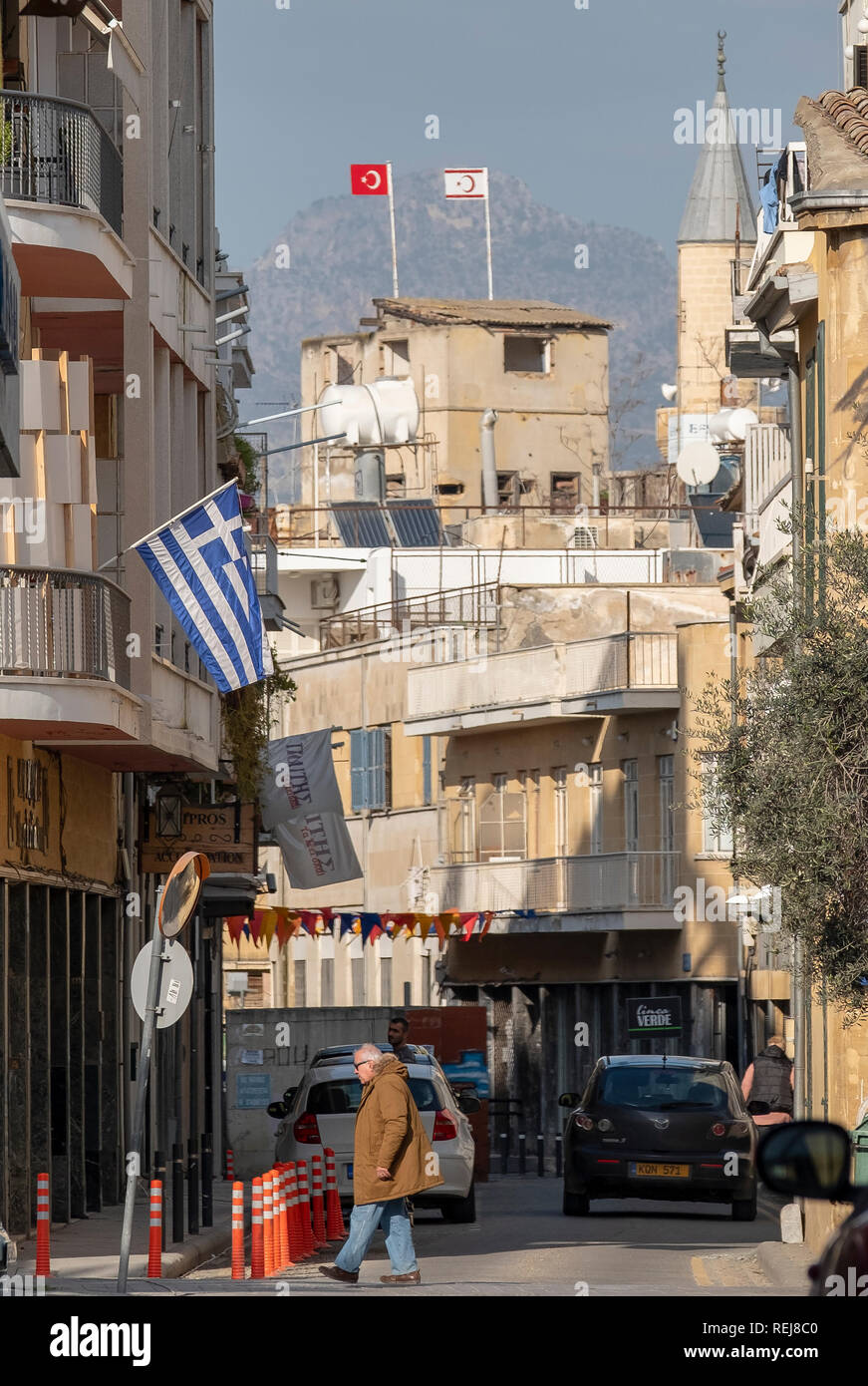A view across the buffer zone in Nicosia, Cyprus between the Greek Cypriot and Turkish Cypriot sides of the last divided city in europe. - Stock Image
