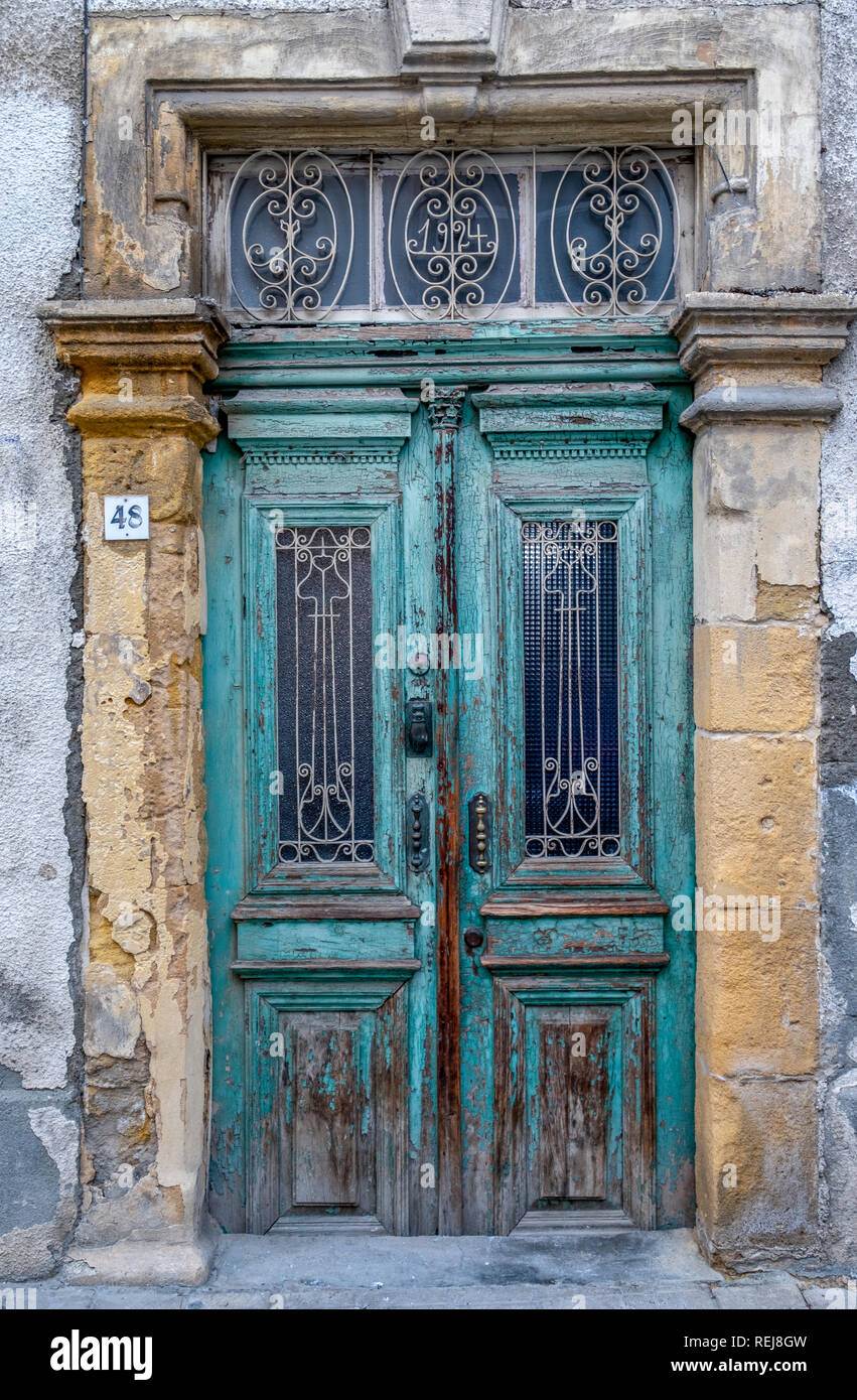 A faded traditional Cypriot door in Nicosia, Cyprus - Stock Image