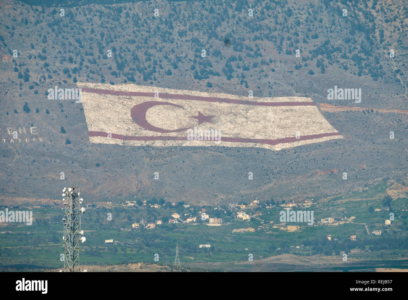 A giant flag marked on the slopes of the south side of Kyrenian mountains facing Nicosia and the Republic of Cyprus Stock Photo