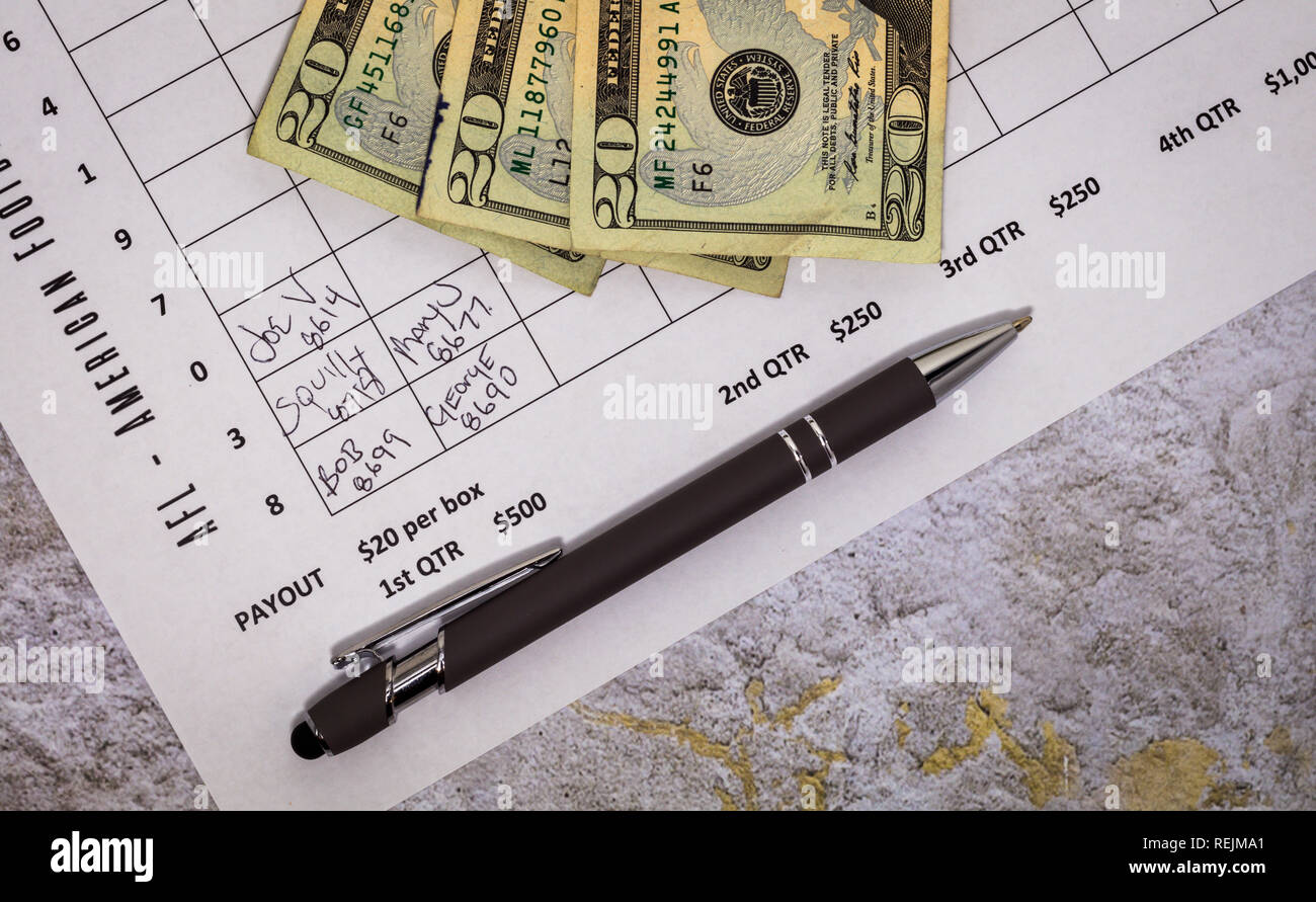 Football American office pool grid for sports betting concept - flat lay - Stock Image