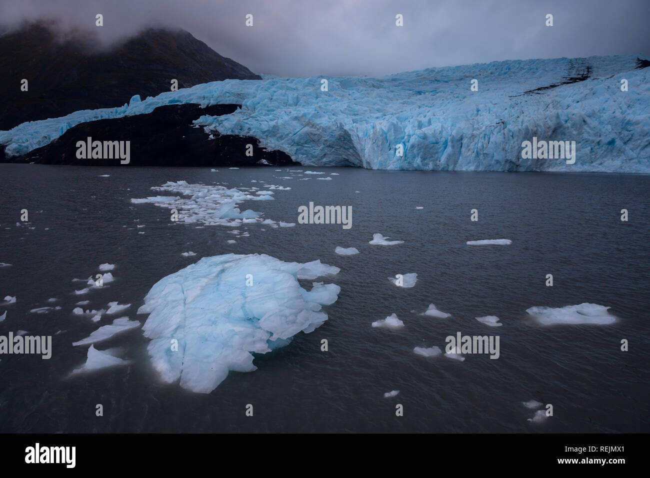 Icebergs float away from the foot of Portage Glacier - Stock Image