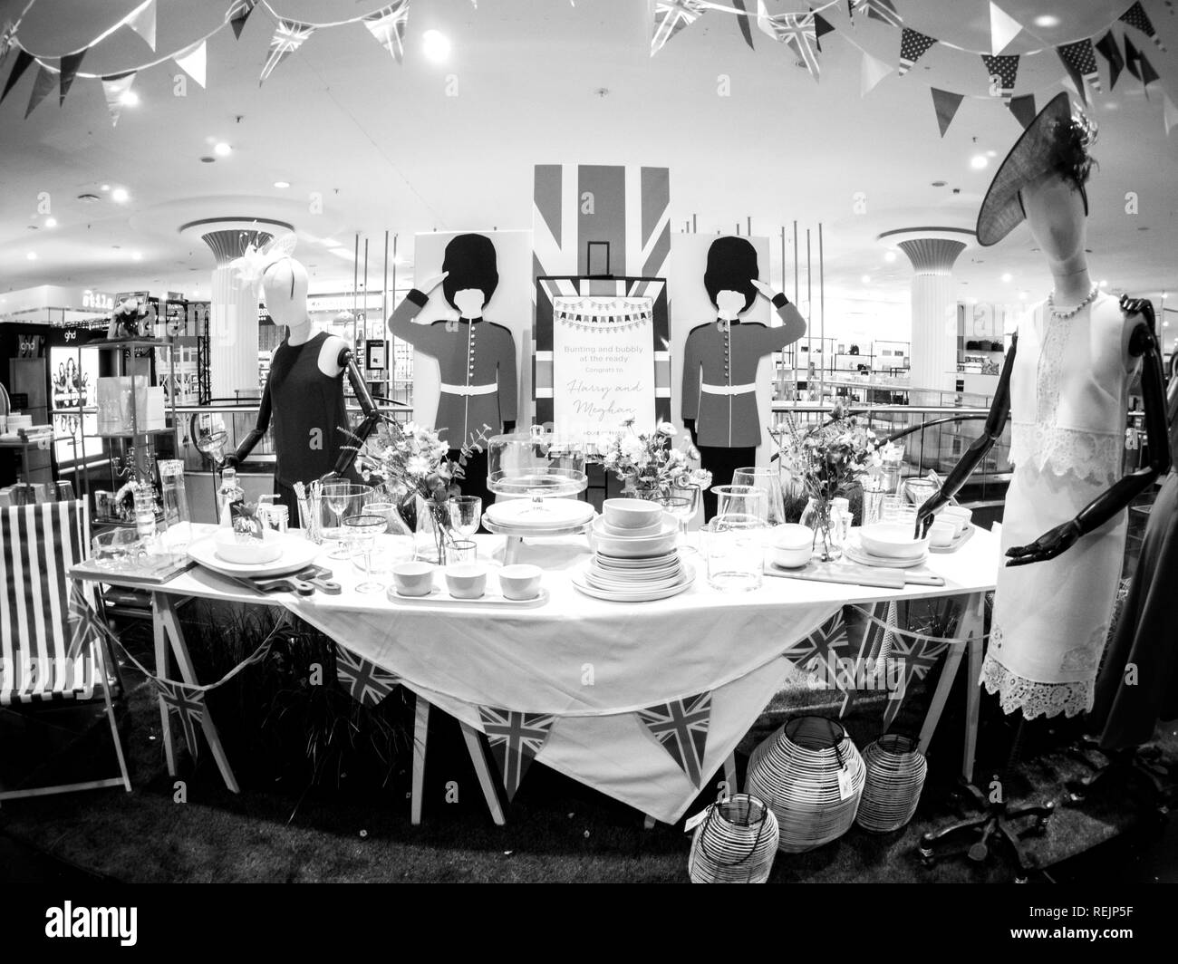LONDON, UNITED KINGDOM - MAY 18, 2018: Congratulation message House of Fraser store to HRH Prince Harry of Wales KCVO and Ms Meghan Markle on Regent street for Royal Wedding - black and white Stock Photo