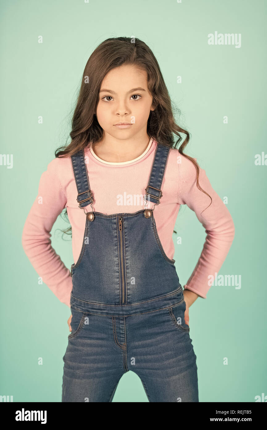 Kid Fashion Casual Style Little Girl Pose In Jeans Overall