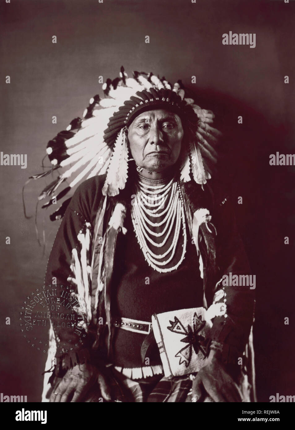 Hin-mah-too-yah-lat-kekt, also known as Chief Joseph, Nez Perce Chief, Seated Portrait in Traditional Dress, 1900 - Stock Image