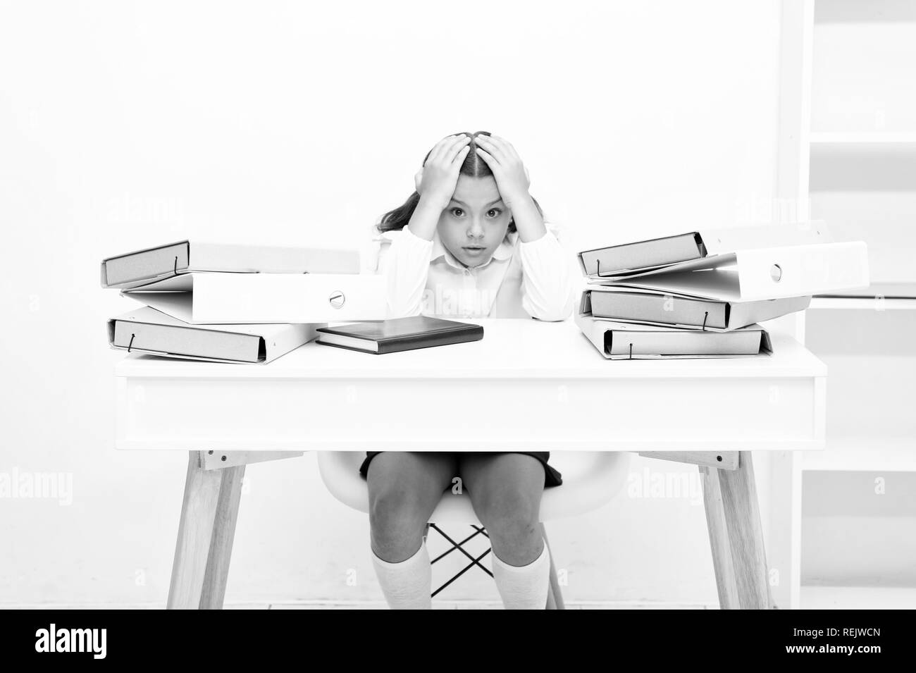 Work concept. Little child stressed with paper work. School girl overloaded with file work. That is too much work for me. - Stock Image