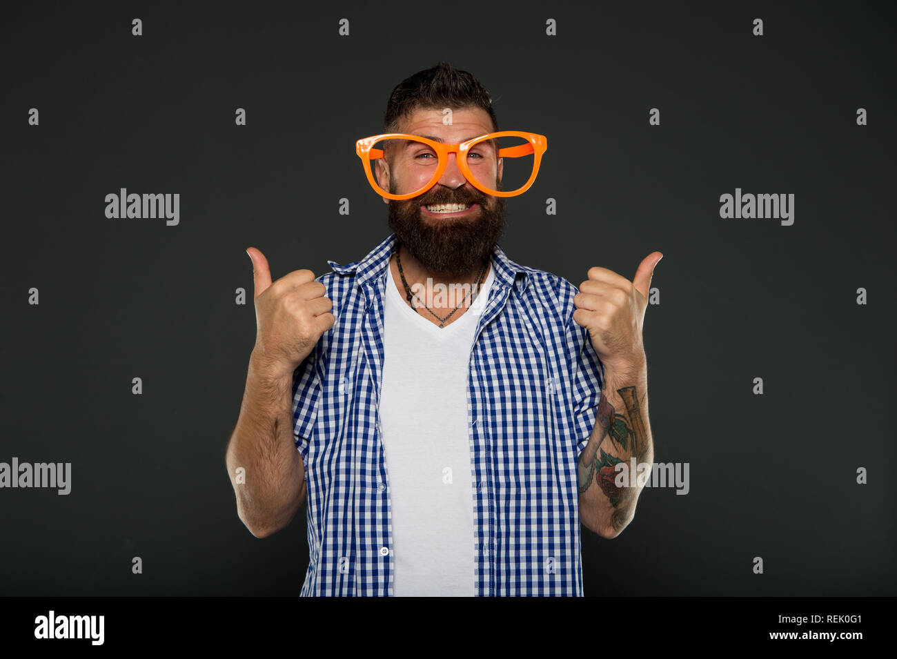 Human strengths and virtues. Positive mood. Positive psychology. Overcome life troubles with smile. Happiness and positive. Stay positive. Man brutal bearded hipster wear funny eyeglasses accessory. - Stock Image