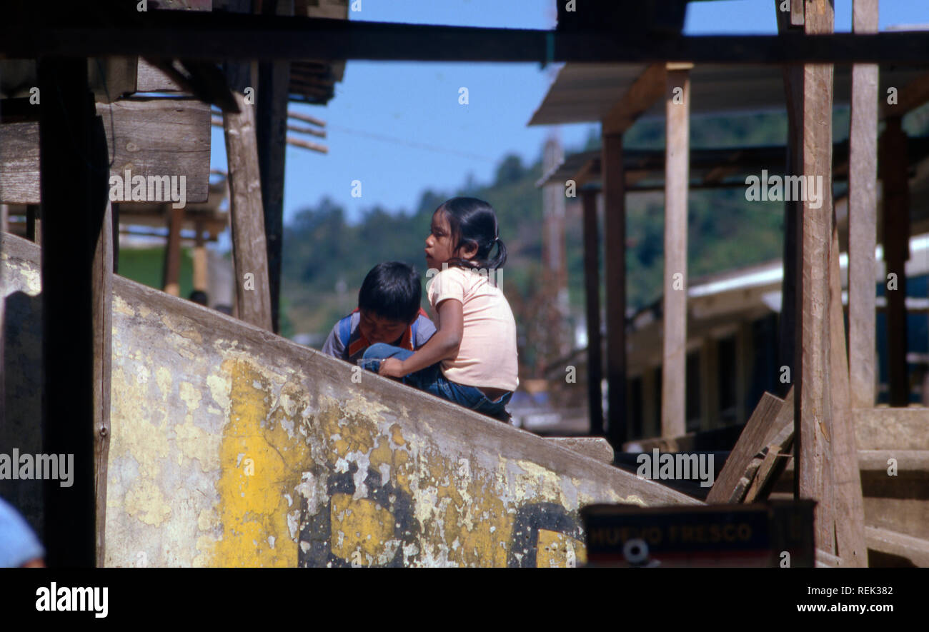 Indigenous Tzeltal wait for their parents at the marketplace in Oxchuc, Chiapas State, Mexico. - Stock Image