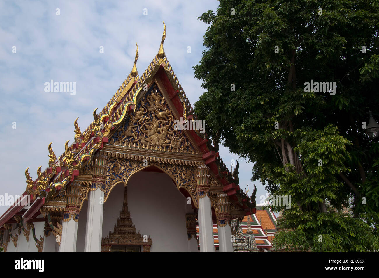 Bangkok Thailand, thai temple with ornate pediment and roof at Wat Pho - Stock Image