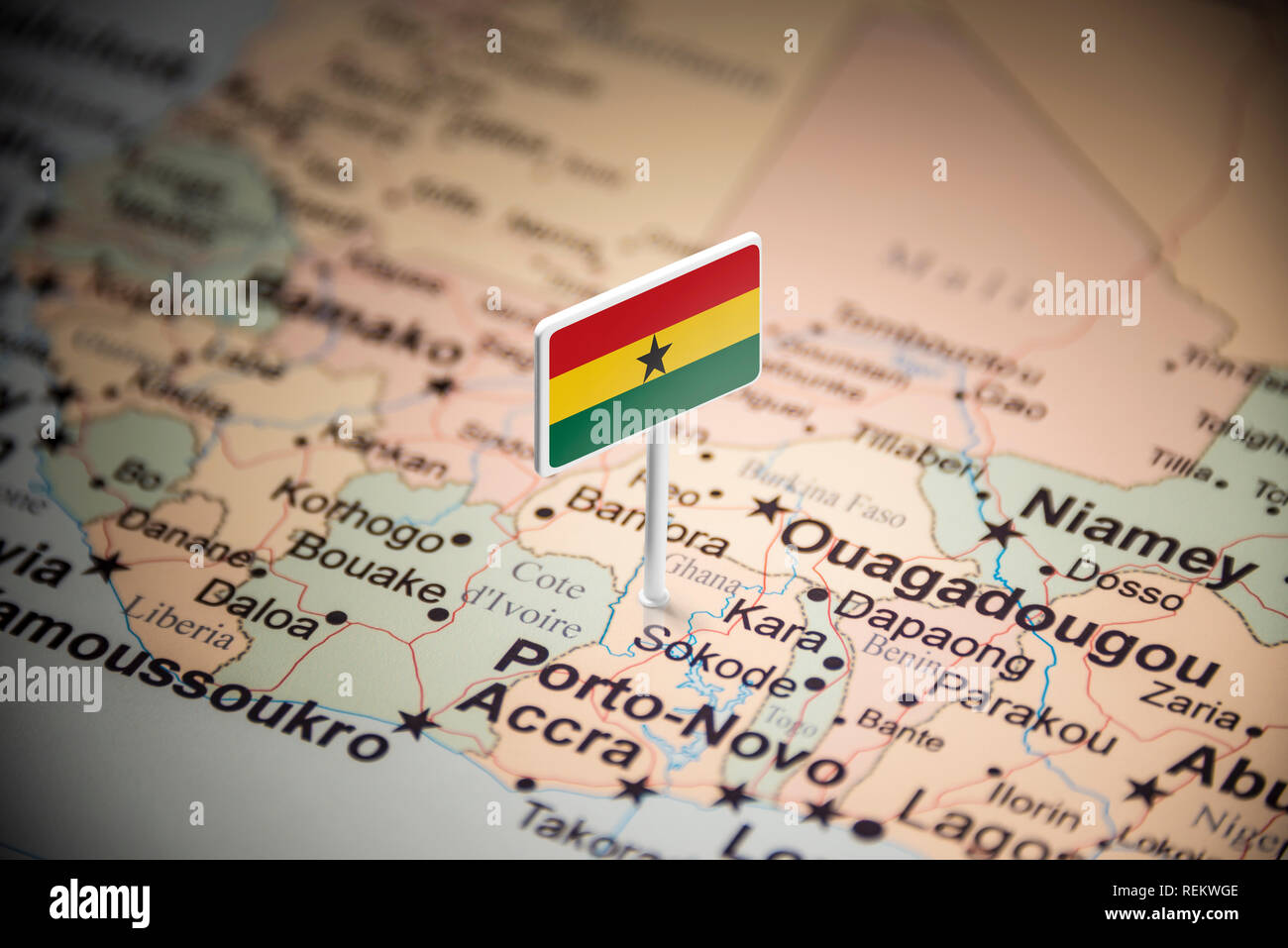 Ghana marked with a flag on the map - Stock Image