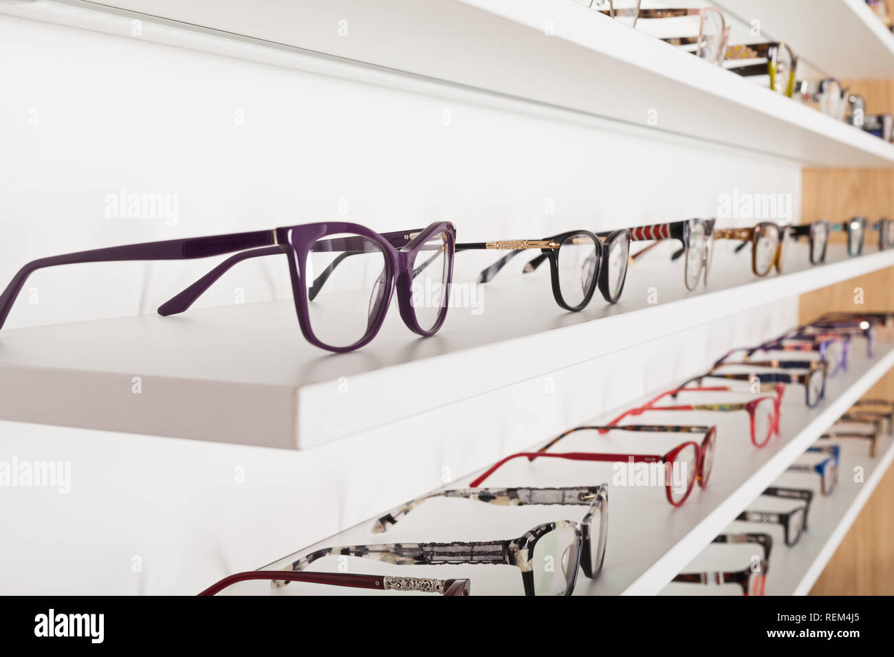 Picture of corrective eye glasses in an optics store - Stock Image