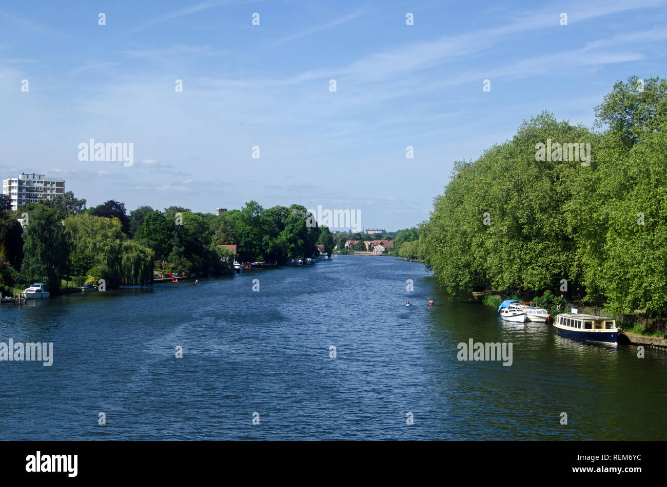 View along the River Thames from Kingston Railway Bridge looking towards Richmond Upon Thames and the landmark Star and Garter Home.  Sunny afternoon  Stock Photo