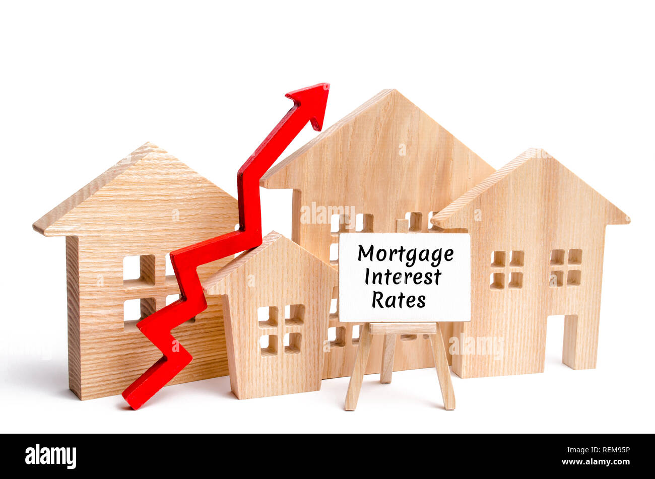 Wooden house and the inscription Mortgage interest rates and up arrow. Raising mortgage rates and tax. The increase in interest charges. Reduced deman - Stock Image