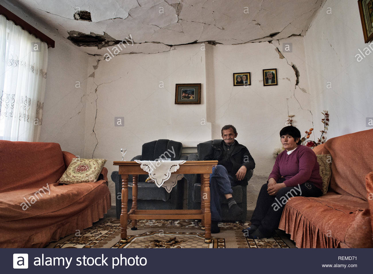 The interior of one of the damaged houses of the village of Patos-Marinza, Fier, Albania. The damages are caused by the practice of oil extraction known as 'fracking', which has caused many earthquakes in an area still inhabited by small farmers and ranchers. - Stock Image