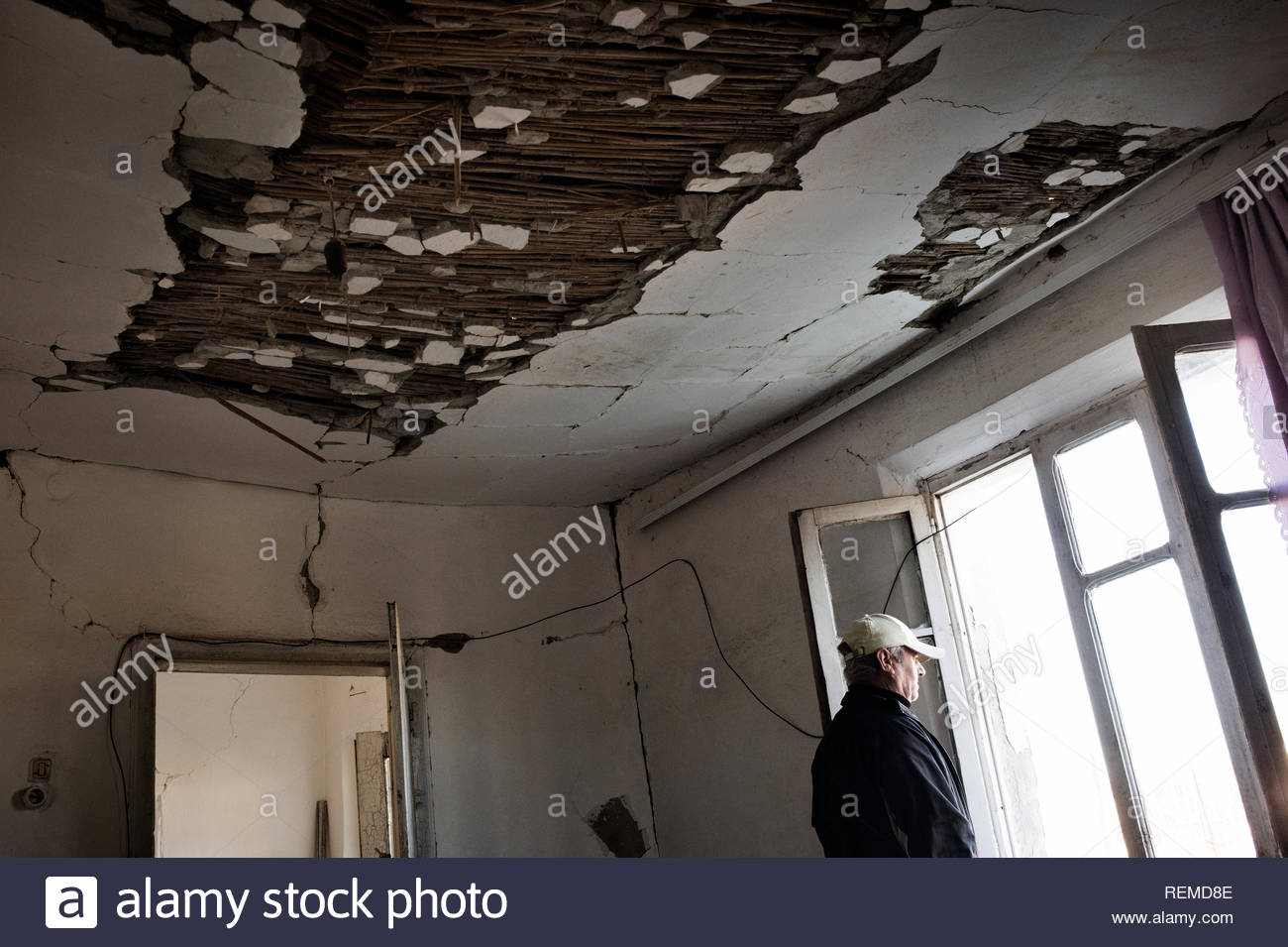 The interior of one of the damaged houses of the village of Patos-Marinza. The damages are caused by the practice of oil extraction known as 'fracking', which has caused many earthquakes in an area still inhabited by small farmers and ranchers. - Stock Image