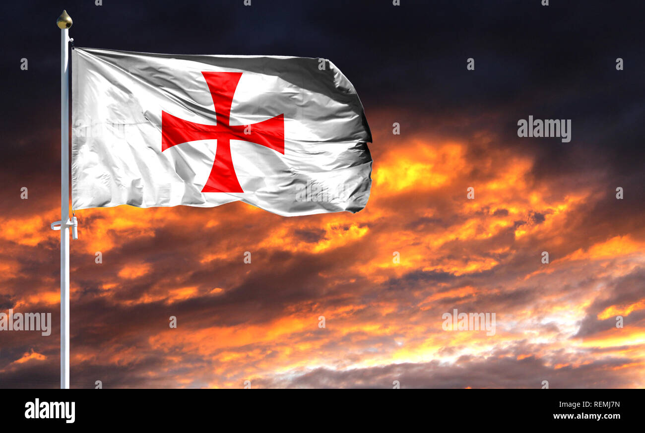 flag of templiers on flagpole fluttering in the wind against a colorful sunset sky. - Stock Image