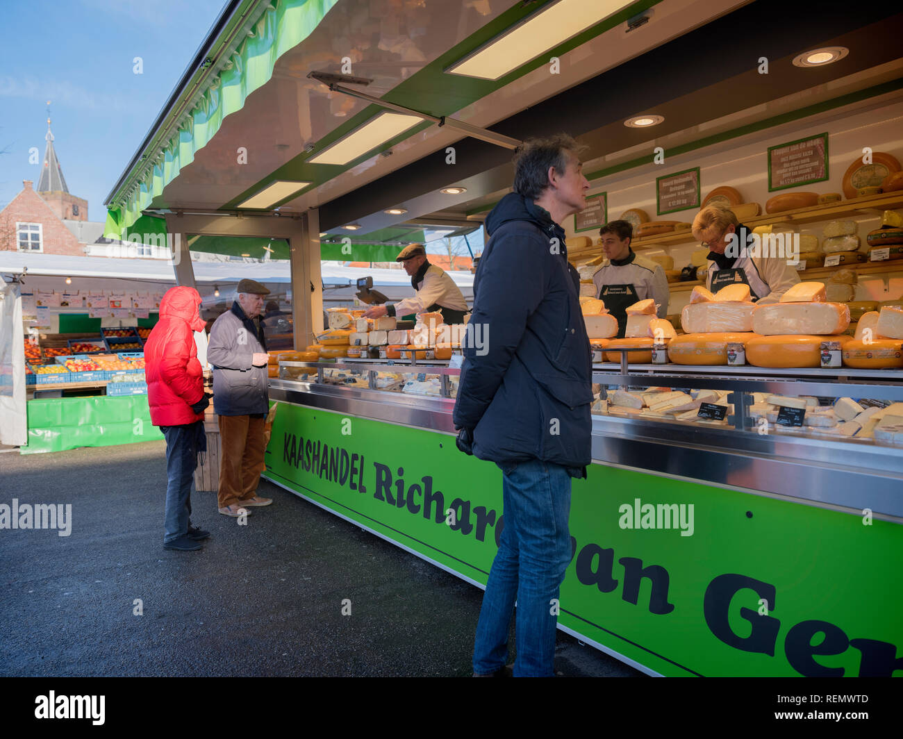 naarden, netherlands, 19 january 2019: people on open air market buy dutch cheese from stall in naarden vesting - Stock Image