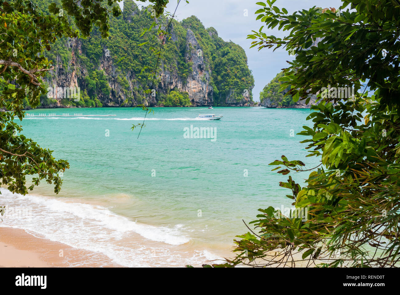 Ao Nang, Krabi - Pai Plong Beach through the foliage of the Monkey Trail. - Stock Image