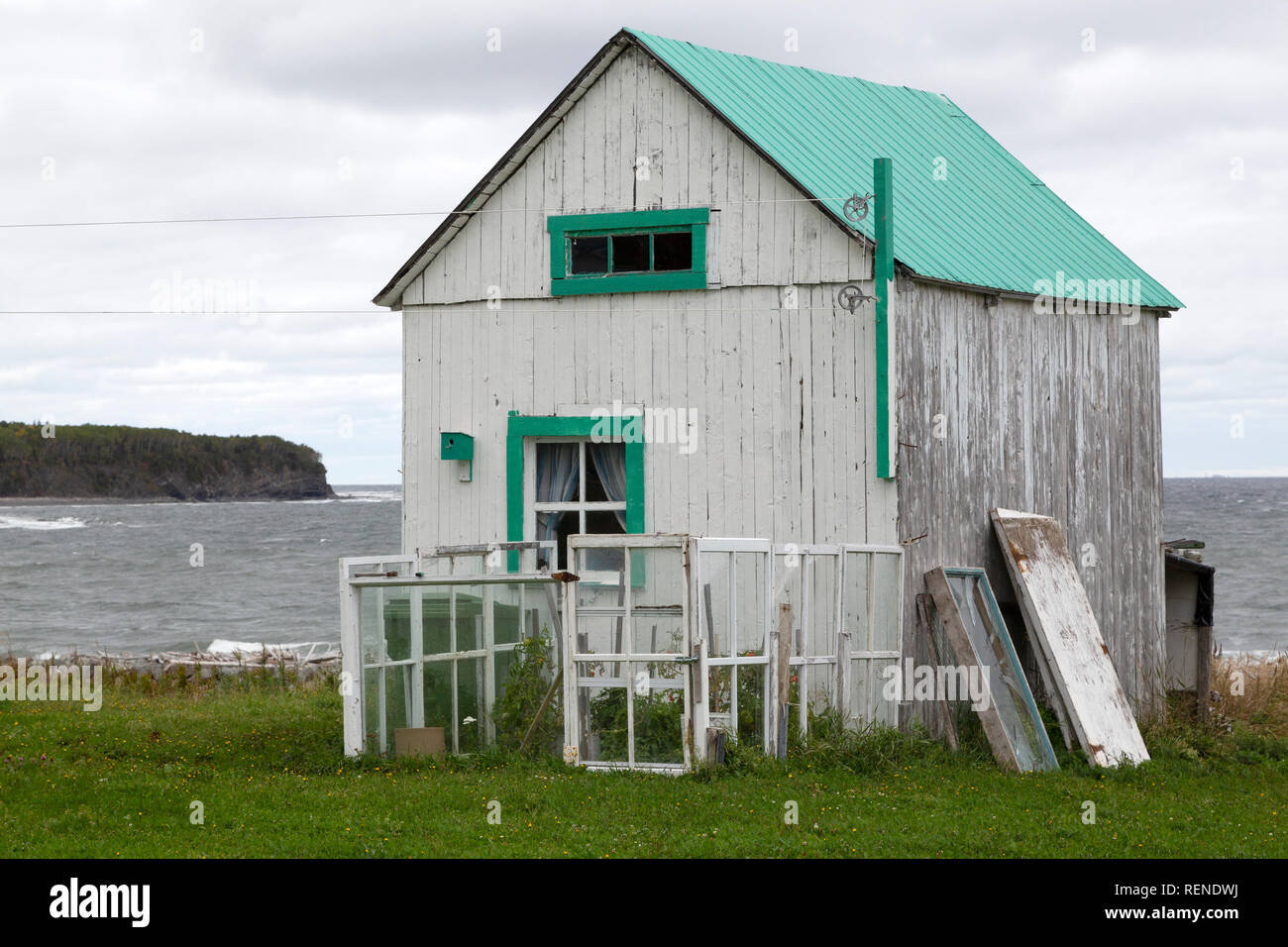 A traditional building by the coast on the Gaspé Peninsula of Quebec, Canada. The building is constructed of wood. - Stock Image