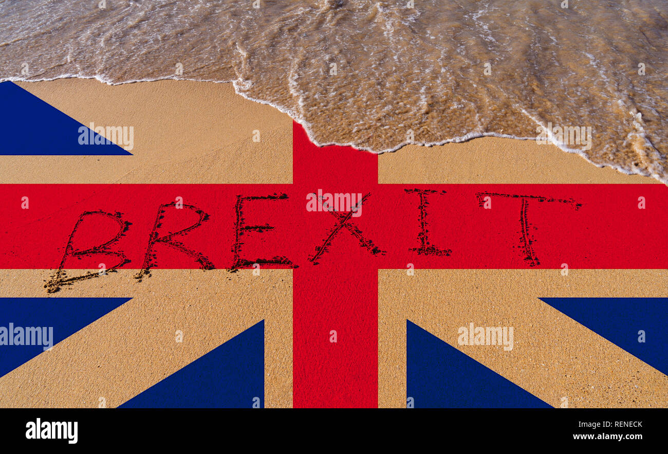 Handwrite text Brexit on sand coastline and foam wave with Great Britain flag pattern on coast. On referendum, voted to exit United Kingdom from EU kn Stock Photo